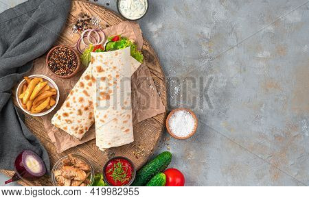 Fast Food: Shawarma, Burrito On A Gray Background With Ingredients. Top View, Copy Space.