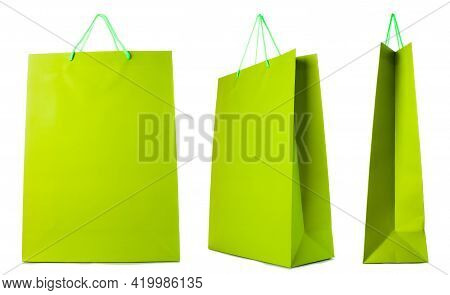 Green Paper Bag Isolated On White Background. Side, Front, Three-quarter View.