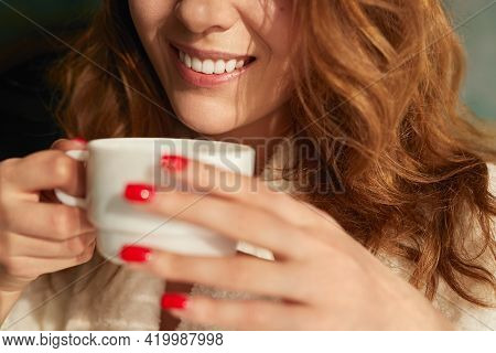 Crop Unrecognizable Long Haired Female Smiling Happily While Drinking Hot Aromatic Coffee In Morning