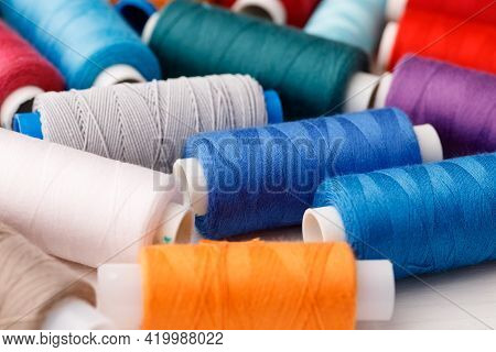 Close Up Of Colored Thread Coils, Thread Spools Background