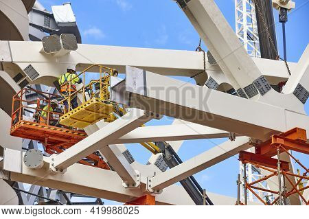 Workers On A Construction Site. Engineering And Architectural Infrastructure. Workplace