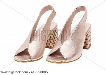Womens Boots And Shoes. Closeup Of A Pair Elegant Female Platinum Coloured Leather High-heeled Shoes