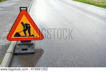 Road Sign With Warning Of Road Work
