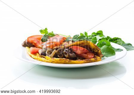 Fried Egg Omelet With Wild Mushrooms And Tomatoes