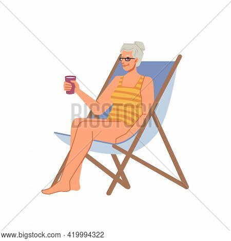 Grandmother Senior Woman In Bikini Swimsuit Sitting On Chaise Lounge With Cocktail, Sunbathing On Be