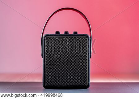 Black Bluetooth Loudspeaker On A Pinkish Background