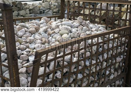 A Metal Cage With Stones For Sale In Warehouse Yard, Outdoor Shot