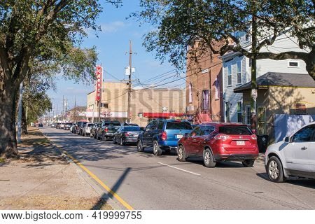 New Orleans, La - January 9: Line Of Cars Backed Up For Several Blocks To Receive Charitable Food Di