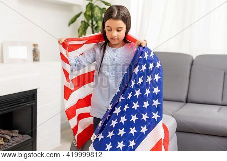 Portrait Of A Little Girl With The Flag Of America. American Education, Study In America