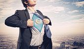 Image of young businessman in superhero suit with euro sign on chest poster