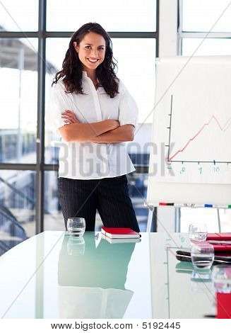Confident Businesswoman Before Giving A Presentation With Crossed Arms