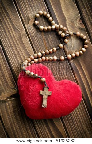 top view of furry heart with rosary beads