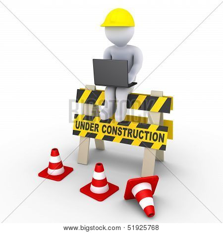 Under Construction Sign And A Worker With Laptop