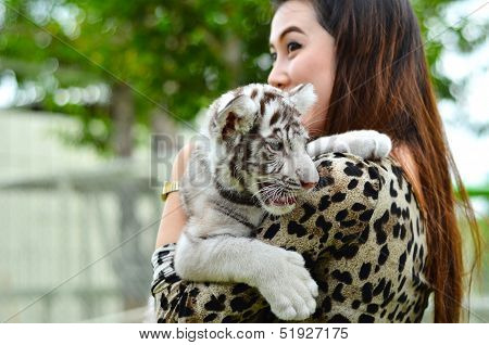 pretty women hold baby white bengal tiger poster