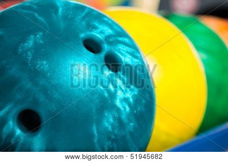 Colorful bowling balls in front of the tenpin alley