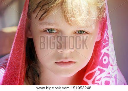 Closeup Portrait Of Calm Blond Caucasian Little Girl In Red Shawl