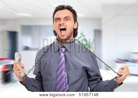 Stressed businessman using the phone cord to strangle himself
