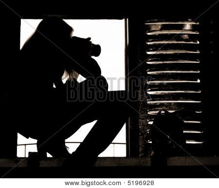 Silhouette Of The Professional Girl-photographer