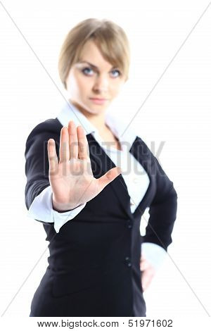 Business woman making stop sign over white focus on hand