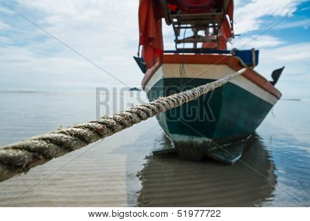 Boat Rope To Anchor On The Beach