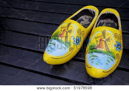 Painted wooden clogs shoes outside, Netherlands, Europe poster