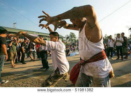 NAKHON CHAI, THAILAND - MAR 23: Unidentified participant Master Day Ceremony able Khong Khuen - spirit possession during the Wai Kroo at Wat Bang Pra on Mar 23, 2013 in Nakhon Chai, Thailand.