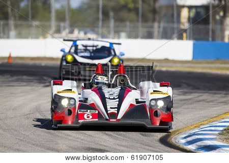 Sebring, FL - Mar 14, 2014:  The Muscle Milk Pickett Racing Oreca takes to the track for a practice session for the 12 Hours of Sebring at Sebring International Raceway in Sebring, FL.