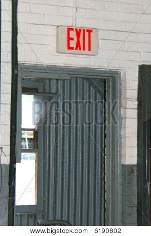 Exit sign on top of doorway.