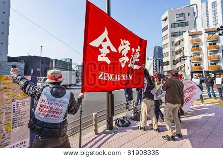TOKYO, JAPAN - MARCH 17, 2014: Zengakuren members protest the annexation of Crimea by Russia. Zengakuren was founded in 1948 as a communist/anarchist league of students.