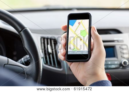 Man Sitting In The Car And Holding A Phone With Interface Navigator On A Screen