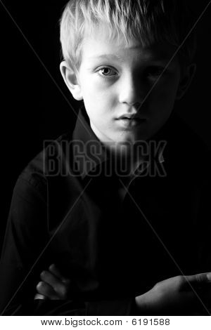 Black And White Shot Of A Sad Blonde Boy