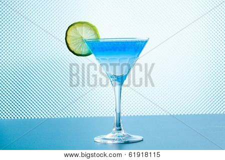 Molecular mixology - Cocktail with blue caracao caviar in a martini glass