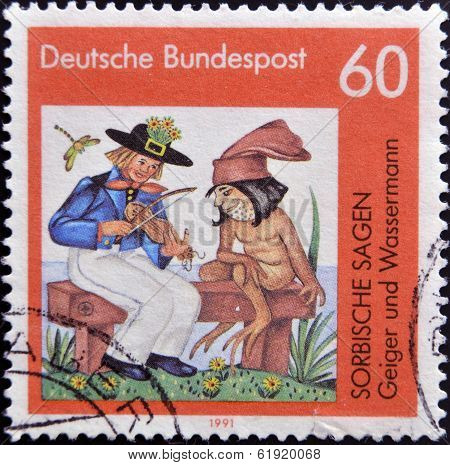 GERMANY - CIRCA 1991: A stamp printed in Germany shows Sorbian legends: Geiger and the waterman
