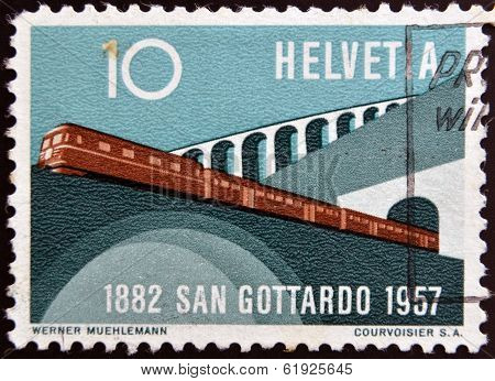 SWITZERLAND - CIRCA 1957: A stamp printed in Switzerland shows train leaving the tunnel circa 1957