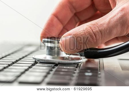 Man Checking The Health Of His Laptop Computer