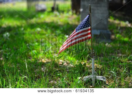 American flag on display at a cemetery