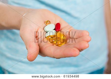 Hand Holding Many Different Pills