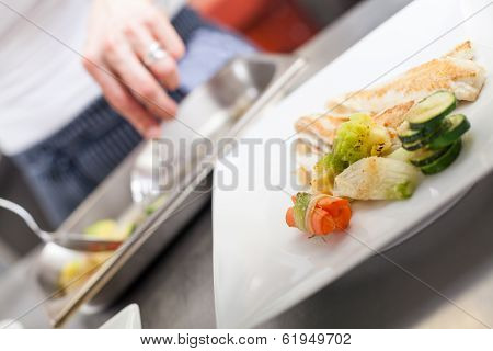 Fried Fish Fillets And Vegetables