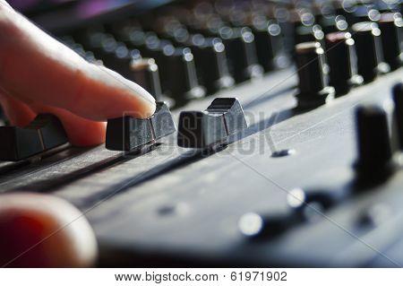 Dj Hand Over A Mixer