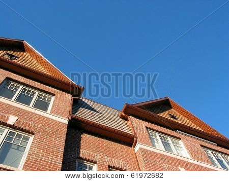 New brick townhomes on a bright sunny day, space for copy