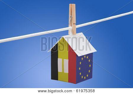 Belgian end EU flag on paper house
