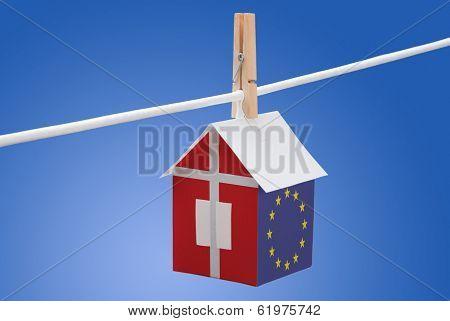 Denmark and EU flag on paper house