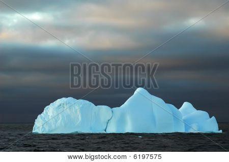 Blue Iceberg With Dark Sky