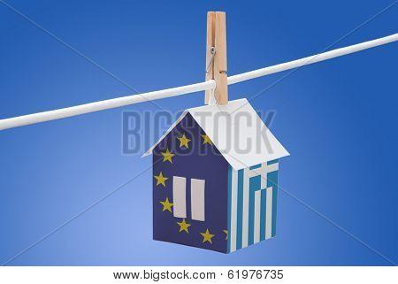 Greece, Greek and EU flag on paper house