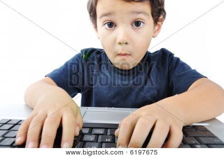 a beautiful kid with his laptop