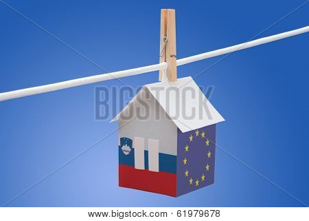 Slovenia, Slovenian and EU flag on paper house