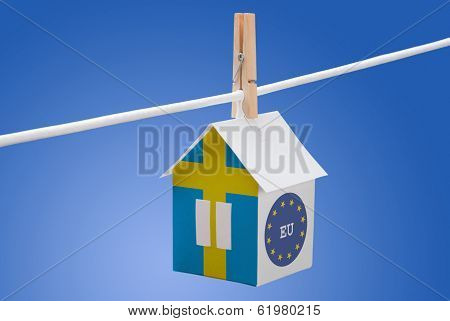 sweden, swedish and EU flag on paper house