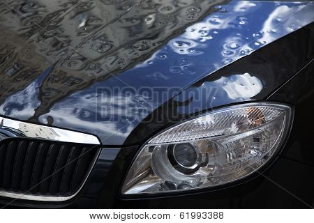 hail damaged black car