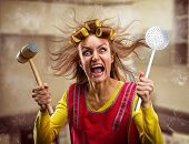 Crazy housewife with kitchen tools poster