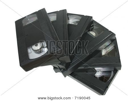 Pile Of Old Video Cassettes Isolated Over White